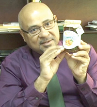 Director of the Institute for Applied Science and Technology (IAST) Dr. Suresh Narine displaying a sample of orange marmalade